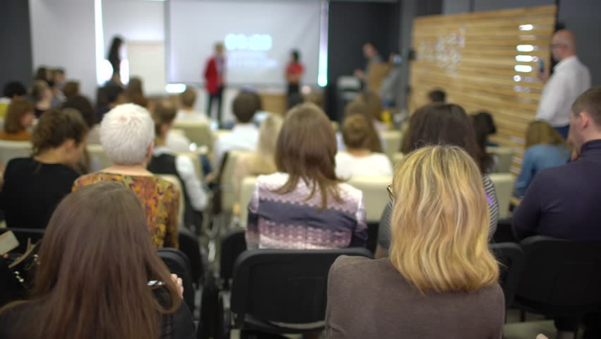 Speaker Coach Business People Seminar Conference Meeting Office Training. lot of people sitting at seminar lectures conferences. Listen to speaker seminar audience coach group marketing management Royalty-Free Stock Footage #1010812169