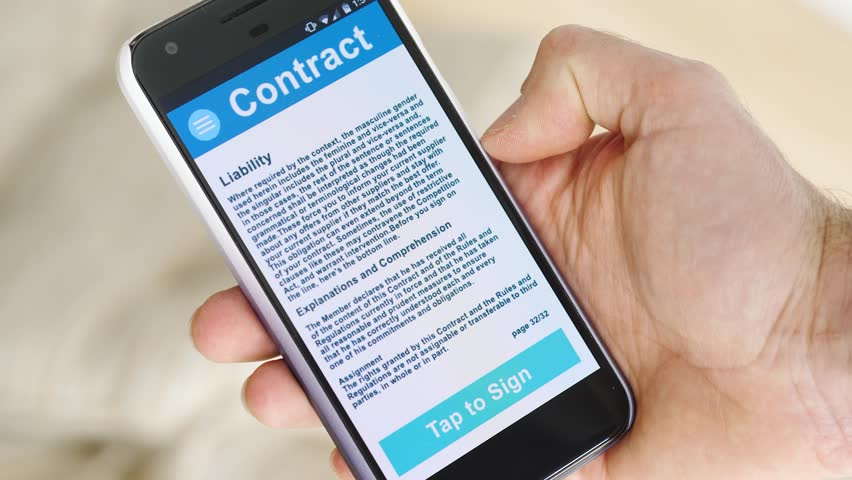 Signing a digital contract on a smartphone device screen.