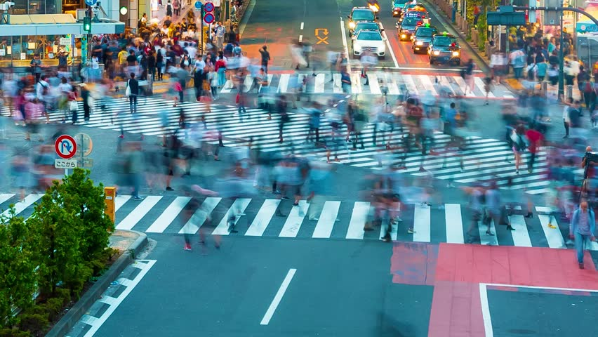 People cross the famous intersection in Shibuya, Tokyo, Japan one of the busiest crosswalks in the world. | Shutterstock HD Video #1010843690