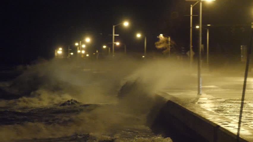 Huge Waves Crash Over Sea Wall During Storm