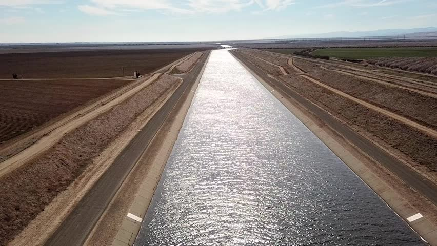 Drone flyover of the California aqueduct in Central Valley of California.