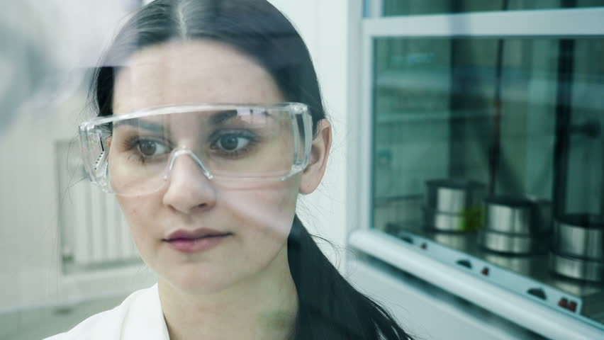 Adult girl after clinical expertise write on the glass discovery way and structural solution of medicaments. Female teacher explaining to pharmacist students pharmaceutical development in university | Shutterstock HD Video #1010855810