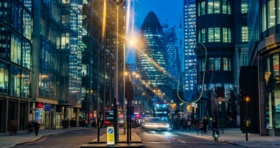 Timelapse view of a busy crossroad at a traffic light in the hearth of the financial district of the City of London Royalty-Free Stock Footage #1010863598