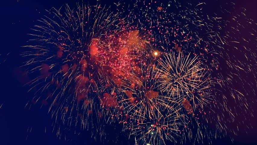 Red and yellow sparkles of fireworks.    Shutterstock HD Video #1010870756