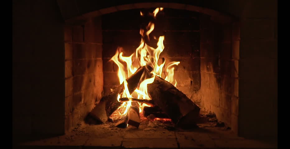 Burning Fire In The Fireplace. Slow motion. A looping clip of a fireplace with medium size flames | Shutterstock HD Video #1010871704