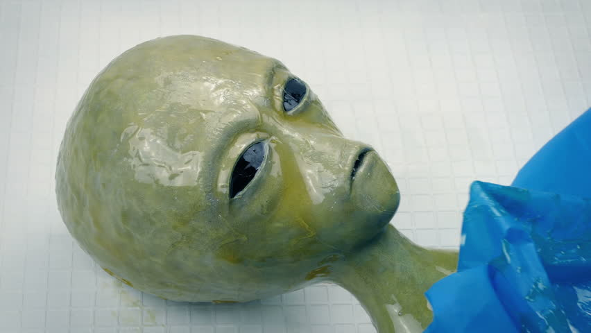Slimy Alien Uncovered On Lab Table