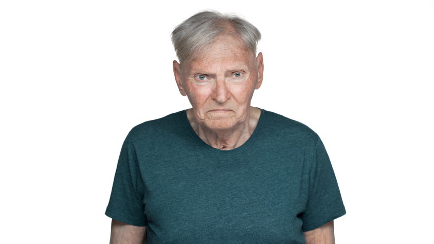 Portrait of dissatisfied old aged man 80s having gray hair in basic t-shirt grimacing on camera with disgust on his face and expressing dislike, isolated over white background | Shutterstock HD Video #1010890580