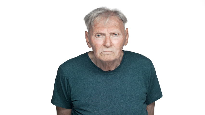 Portrait of displeased old aged man 80s having gray hair in basic t-shirt staring at you with suspicious gaze slow motion, isolated over white background | Shutterstock HD Video #1010890619