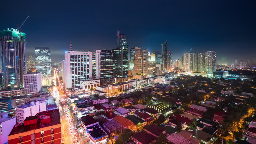 Manila, Philippines - December 12, 2017: Manila Timelapse view showing city skyline at Burgos area and view over exclusive Bel Air village at night | Shutterstock HD Video #1010896313