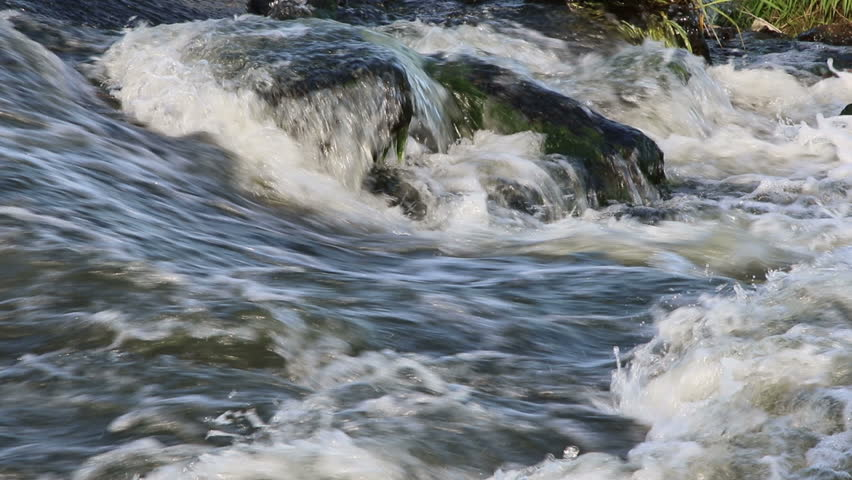 Close-up of water stream. Water flows in waterfall. | Shutterstock HD Video #1010897993