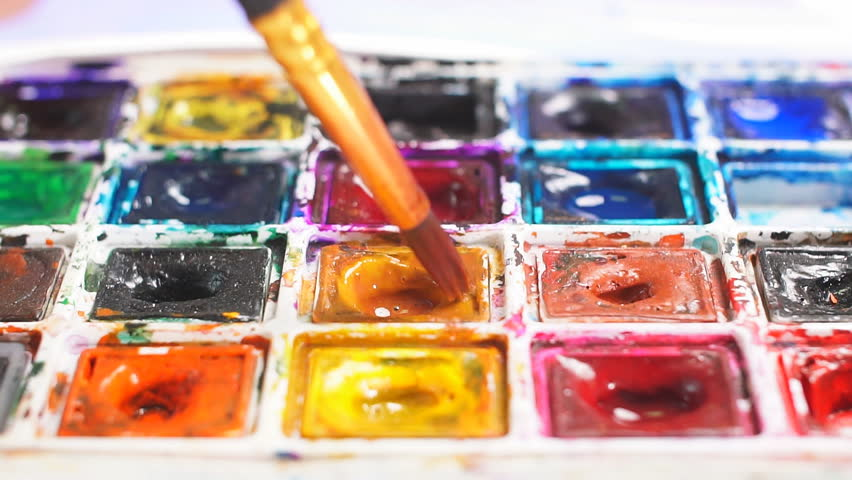 Woman artist mixing oil colours on palette holding in her hand. | Shutterstock HD Video #1010936111