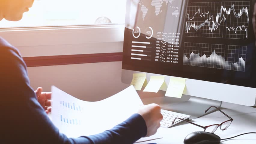 Financial report analytics, business man studying charts, graphs and diagrams on dashboard on computer screen, fintech concept, KPI, businessman working in office