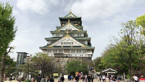 OSAKA,JAPAN-APRIL 16,2018: Tourist enjoying a spring day at one of Japans most famous landmarks the Osaka Castle.