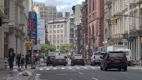 NYC, USA - 05.10.2017: Streets and intersections Soho. Manhattan in motion. Dolly shot.