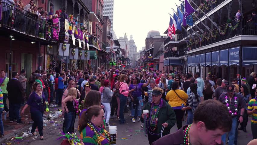 NEW ORLEANS, LOUISIANA - FEBRUARY 9:Busy Mardi Gras Bourbon Street during celebration on February 9, 2018, in New Orleans, Louisiana.