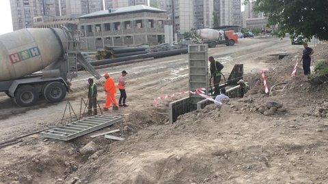 Armenia, Yerevan, 12-may-2018, North-South way building. New Davitashen street, 16 block, bridge. Hayastan, Erevan. 1920x1080. FHD. Construction workers pour concrete mix from cement.