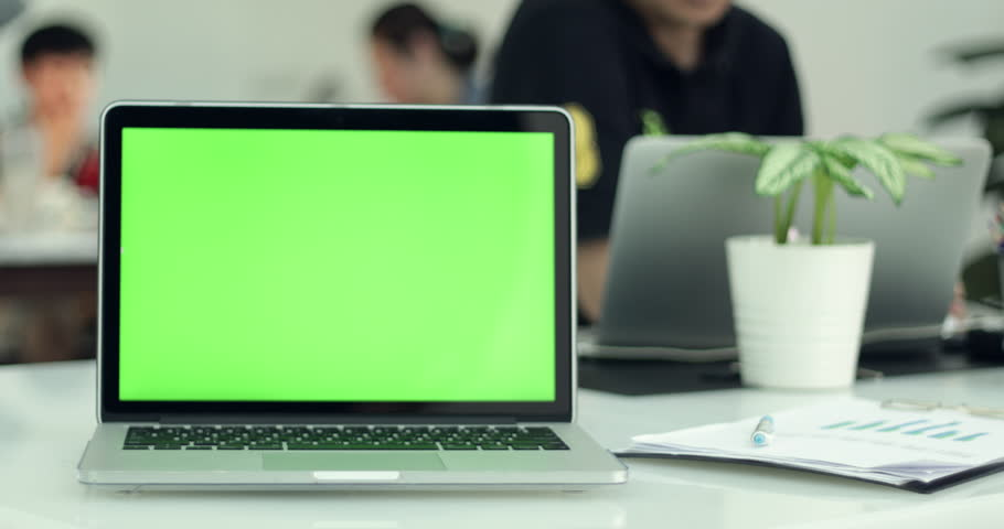 Green laptop computer screen set in front of workgroup #1011012266