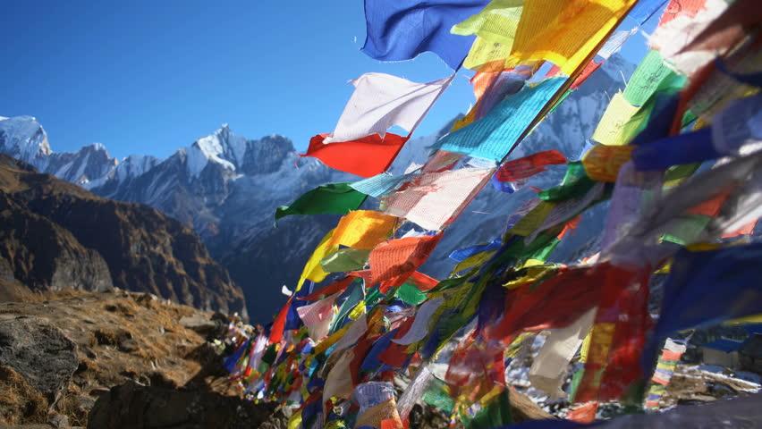 Buddhist prayer flags in the Himalaya mountains, Annapurna base camp, Nepal, Asia.
