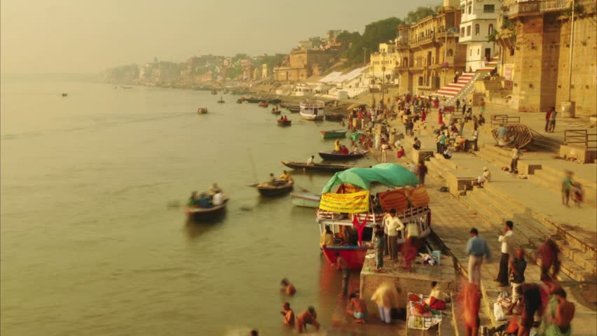 Time lapse Indian pilgrims rowing boat in sunrise, Ganges river at Varanasi, India. 4k footage video.