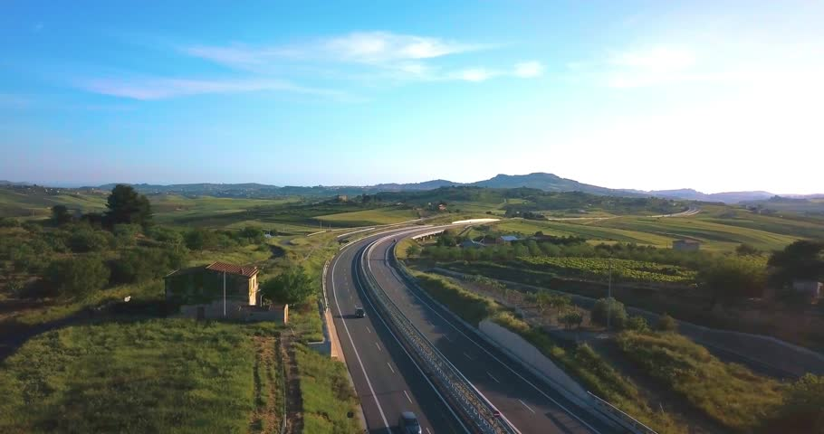 Top view over the highway, expressway and motorway, Aerial view interchange with car driving down the highway. | Shutterstock HD Video #1011070742