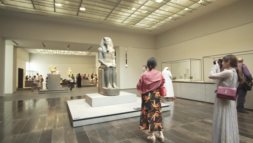 Abu Dhabi, UAE - April 04, 2018: People looking at exhibits in the new Louvre Museum in Abu Dhabi stock footage video