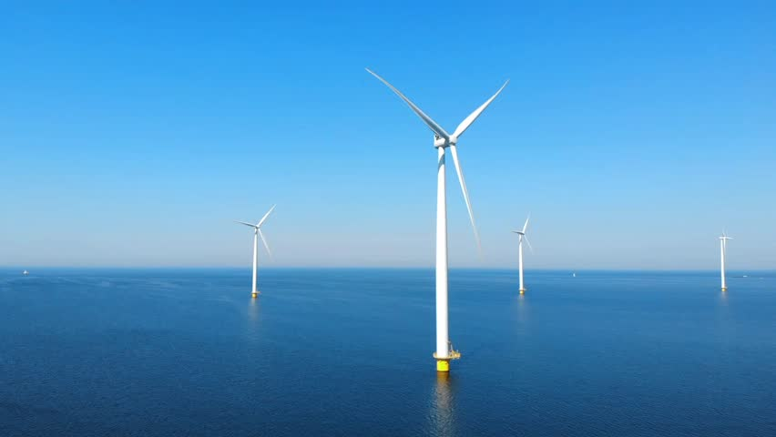 Wind turbine from aerial view, Drone view at windpark westermeerdijk a windmill farm in the lake IJsselmeer the biggest in the Netherlands,Sustainable development, renewable energy Royalty-Free Stock Footage #1011085787