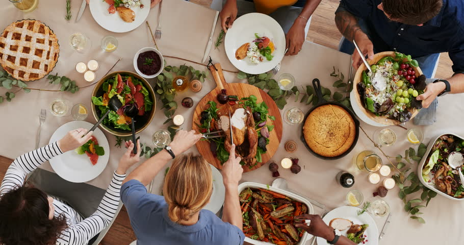 Top view of woman carving thanksgiving  turkey young cheerful multi ethnic friends preparing table enjoying vibrant festive season meal together talking bonding over healthy food time lapse rotate | Shutterstock HD Video #1011087269