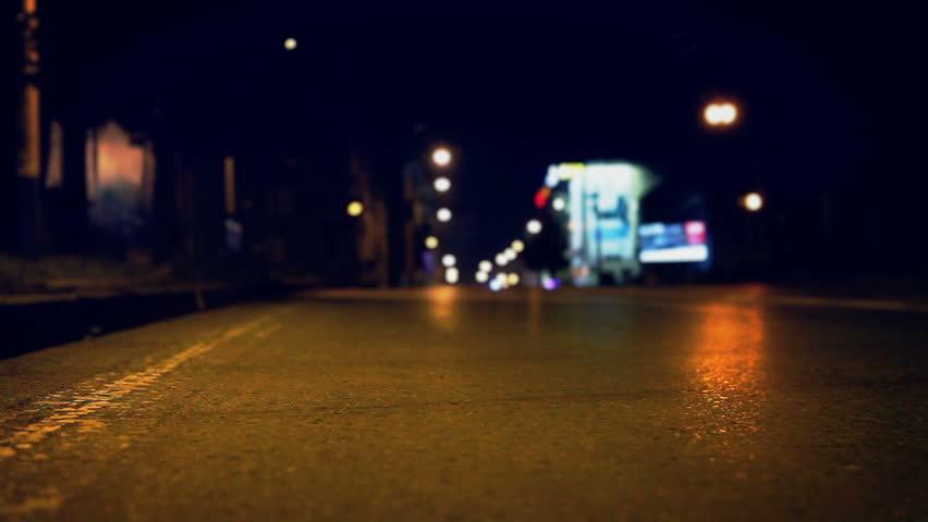 Night empty street on asphalt road slider footage