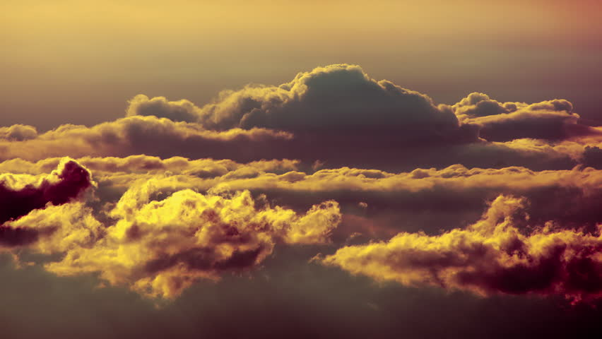 Golden sunset clouds from top of mountain in timelapse.Dark clouds forming on a stormy rainy day at sunrise or sunset,at high altitude.All unwanted items planes,birds etc have been digitally removed.