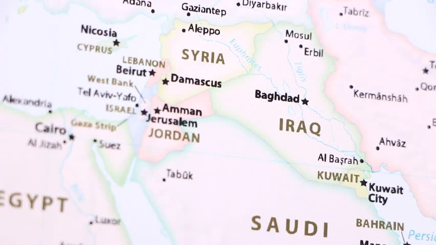 Iraq on a political map of the world. Video defocuses showing and hiding the map.