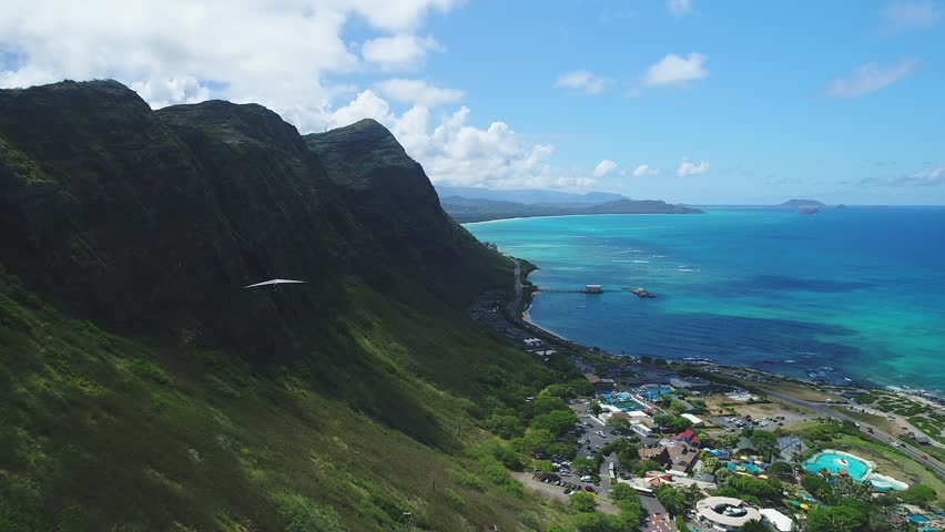 Aerial of Hawaii cliffs, coastline and mountains near Honolulu. | Shutterstock HD Video #1011183401