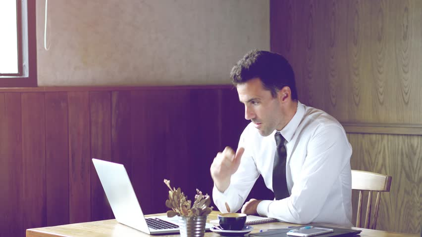 Ambitious businessman enjoy working or learning on his laptop