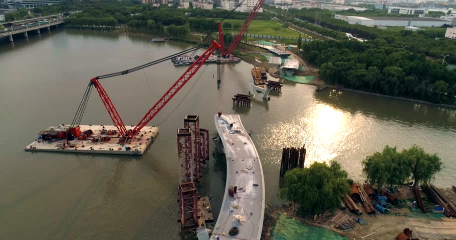 Aerial view of floating crane, pedestrian bridge construction | Shutterstock HD Video #1011199601