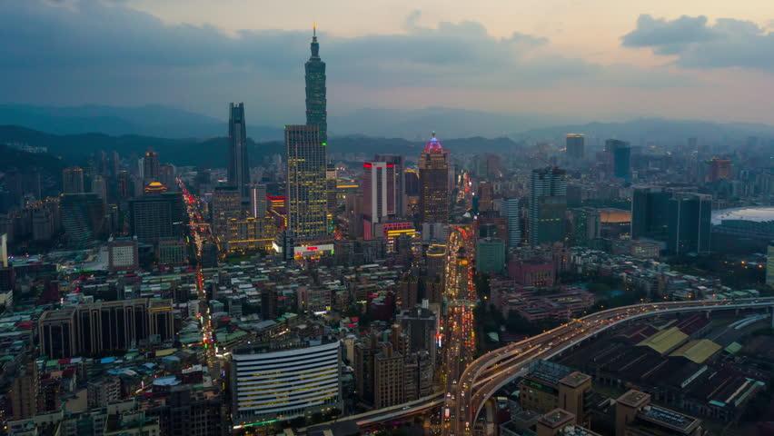 Sunset illumination taipei cityscape downtown traffic aerial panorama 4k timelapse taiwan