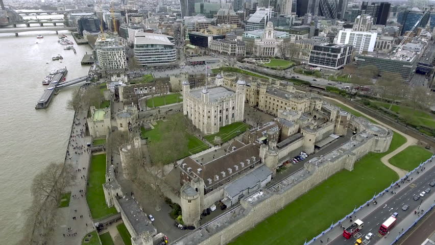 Aerial Bird Eye View Tower of London Her Majesty's Royal Palace and Fortress Historic Iconic Building in England, UK.  History around a Medieval Castle is a Famous Tourist Destination Landmark 4K - HD