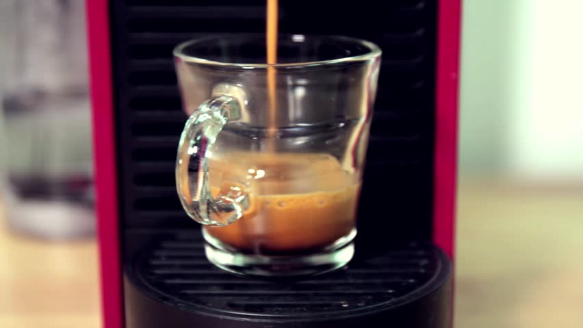 Automatic coffee machine with coffee capsules or coffee pods. Slide camera action