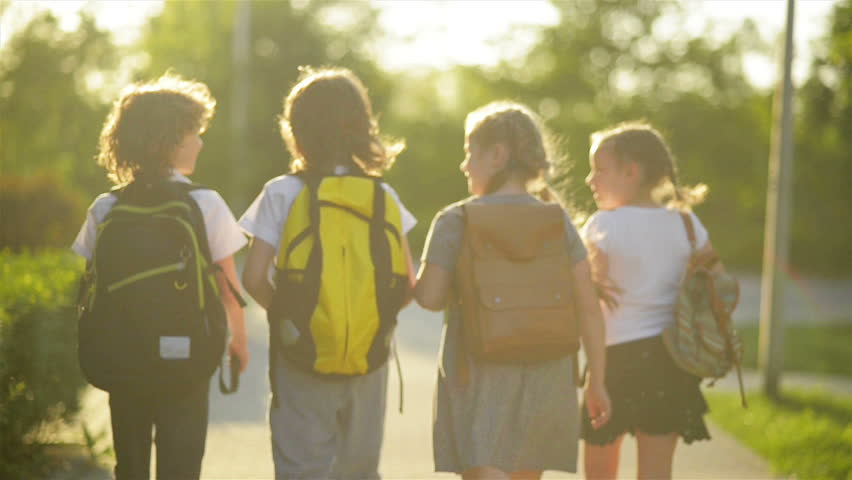 Four Friends Are Going to School. They Have A Lot of Fun Because Today is Their First Day at School. | Shutterstock HD Video #1011215675