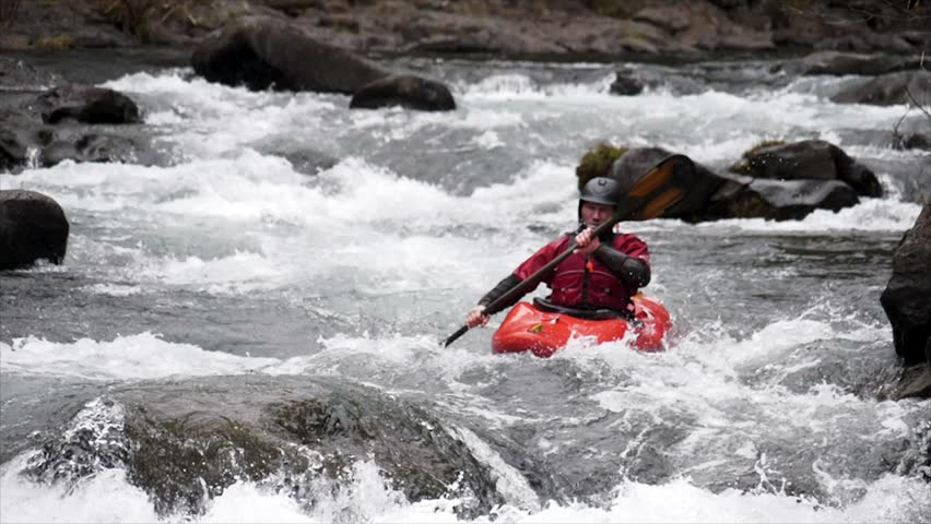 Super slow motion of a man kayaking a wayerfall | Shutterstock HD Video #1011230072