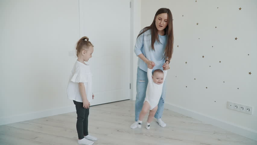 Young mother playing whith her cute baby boy. Slow motion family concept video. | Shutterstock HD Video #1011236633