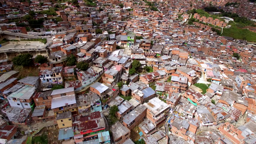 Medellin, Colombia, aerial view of Comuna 13 slums. Once one of the most dangerous neighbourhoods in Colombia, the Comuna 13 reinvented itself in recent times and is now considered safe to visit. Royalty-Free Stock Footage #1011239075