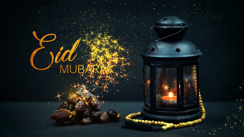 "Eid Mubarak Greeting Gold Glitter Particles. Ramadan Candle Lantern with Wooden Prayer Beads and Dates. ""Eid Mubarak"" means ""Blessed Festival"""
