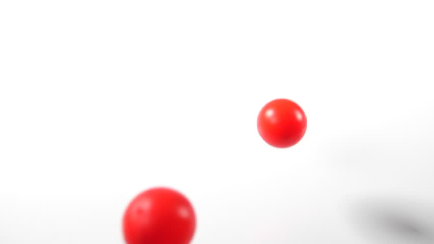 bouncing balls popping and rolling onto around on a white background, red ping-pong plastic fun ball movement.