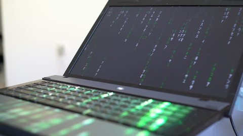 Hacker, Programmer, With the help of the Keyboard, Use the Program code on the Computer for exposure, hacking, protection, Online, Offline, Security Internet, with the Matrix Effect. Trojan Virus.
