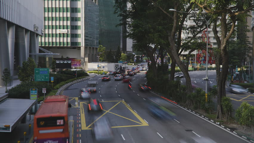 Timelapse shot of street traffic outside Raffles City MRT train station in Singapore | Shutterstock HD Video #1011272921