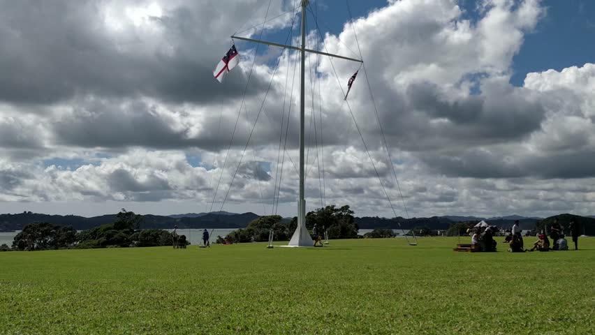 Time lapse, treaty of waitangi grounds in paihia new zealand, flag flying on national holiday. | Shutterstock HD Video #1011292613