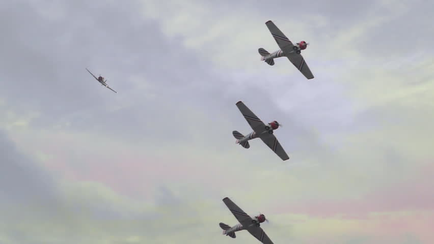 Squadron of World War II P51 military fighter bomber airplanes flying in slow motion  | Shutterstock HD Video #1011300374