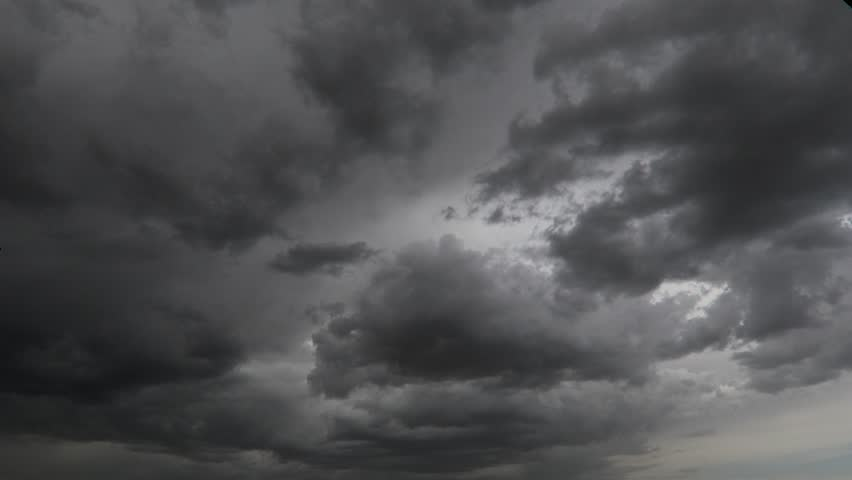 Evening clouds fast moving away, rolling dark sunset clouds 4k black gray white blue glow sunset sky cloud black gray cloudscape time lapse 4k background dark black white sunset sky cloud timelapse 4k