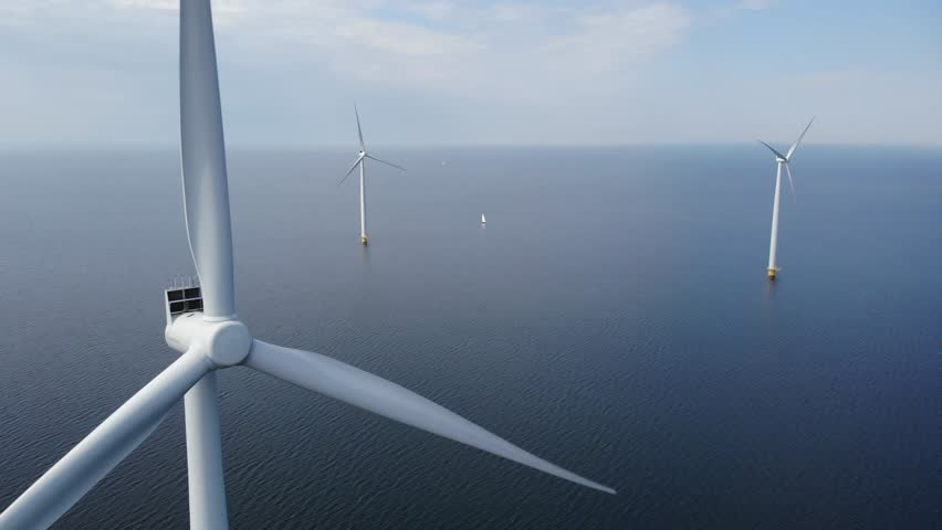 Offshore Windmill farm in the ocean  at the lake IJsselmeer by Urk Netherlands, isolated windmill park at sea, drone view from above out the sky bird eye view Royalty-Free Stock Footage #1011329738