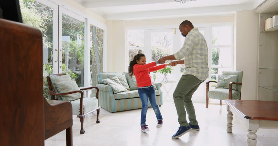 Father and daughter dancing in kitchen at home Social distancing and self isolation in quarantine lockdown for Coronavirus Covid19 | Shutterstock HD Video #1011330326