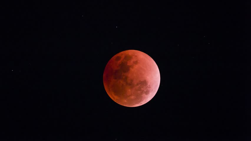 Time laps of Super Blue Blood Moon 2018 of the Jan. 31 total lunar eclipse on clear dark sky , located from Bangkok Thailand view  | Shutterstock HD Video #1011334331